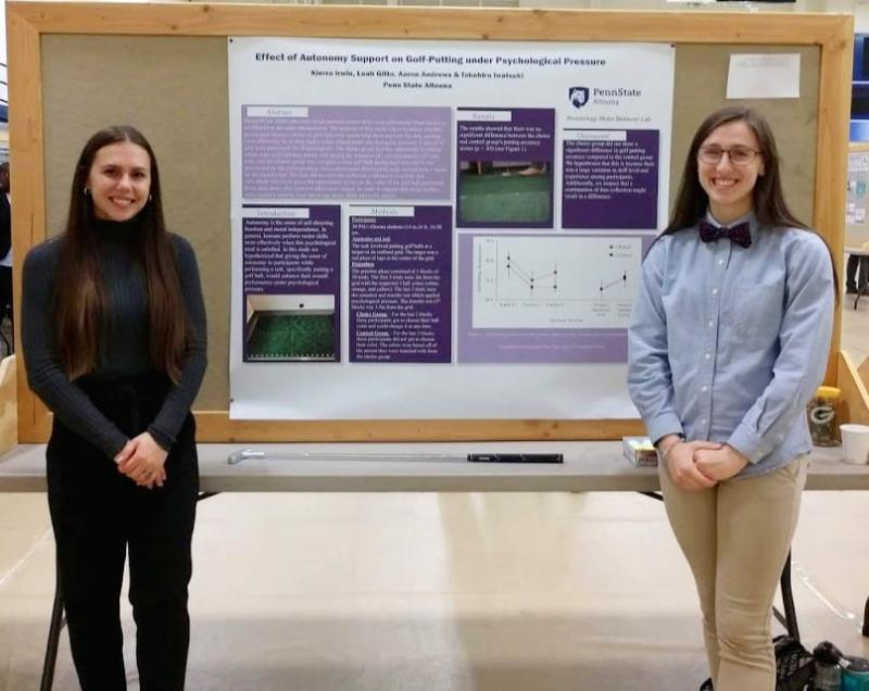 Leah Gitto and Kierra Irwin with their poster at the Undergraduate Research and Creative Activities Fair