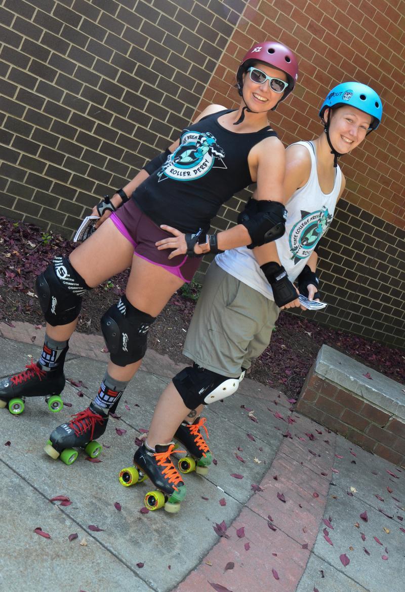 Rebecca Strzelec and Molly Kellom in roller derby gear