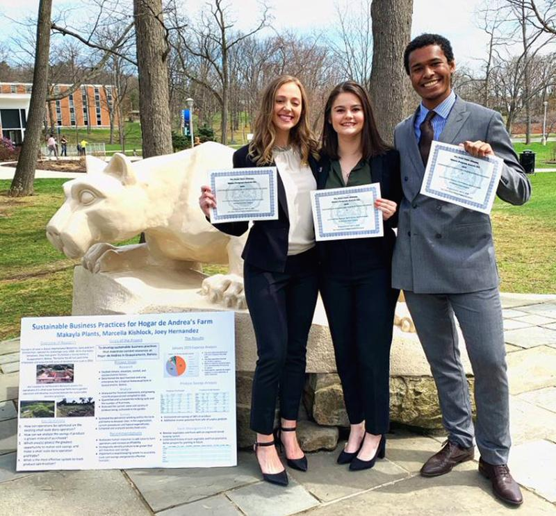 Joey Hernandez poses with partners Marcella Kishlock and Makayla Plants at the annual Undergraduate Research and Creative Activities Fair.