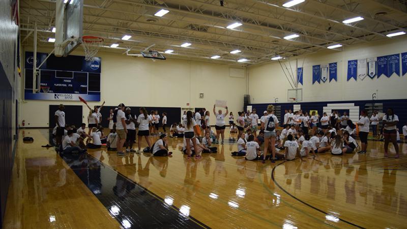 Students in Adler gym preparing for Voluntoona