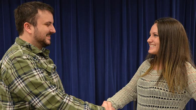 Andrew and Ariana shake hands