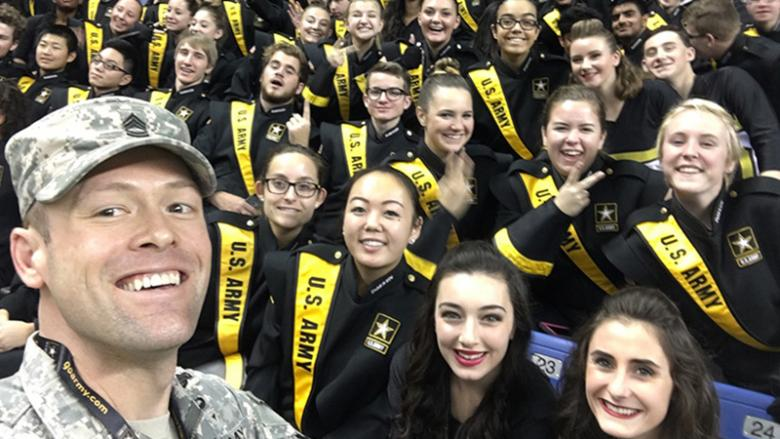 Shepro poses for a selfie with members of the All-American Bowl marching band.