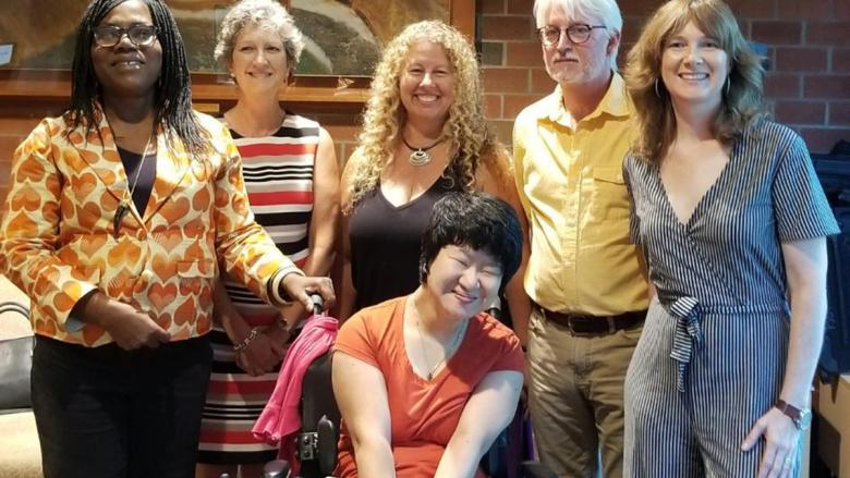 Faculty pose with Erin Kelly at her Chapbook celebration