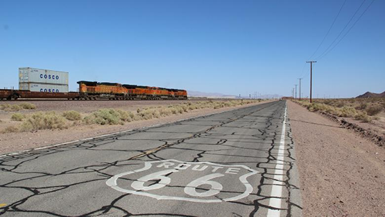 photo of US Route 66 with railroad in the background