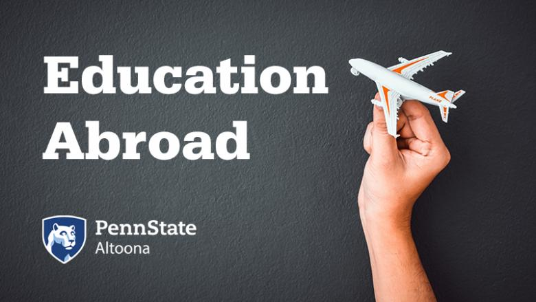 Education Abroad at Penn State Altoona. Toy plane held by hand.