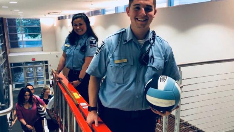 Student auxiliary officers retrieve volleyball