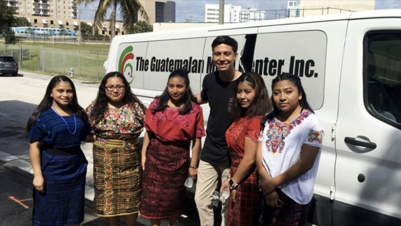 The Mayan Girls, dressed in the traditional outfits they wore to pitch to Philanthropy Tank, stand with their advisor, social worker Daniel Morgan.
