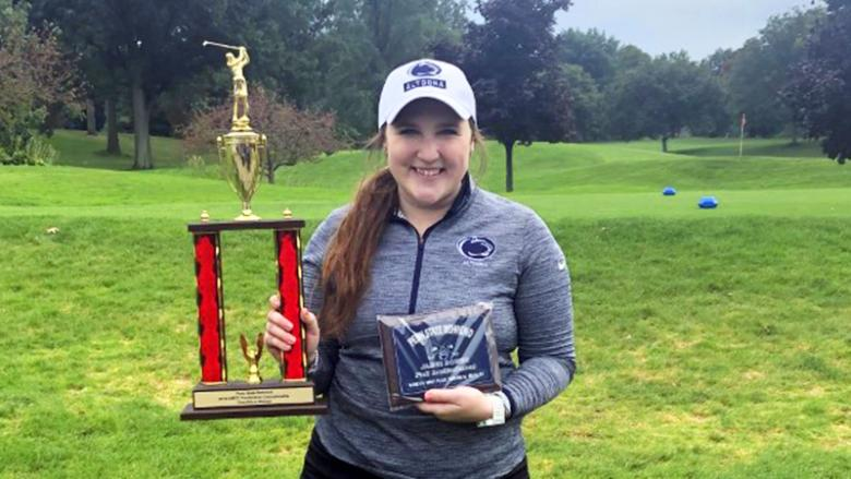 Katie Pupillo poses with her championship trophy and award