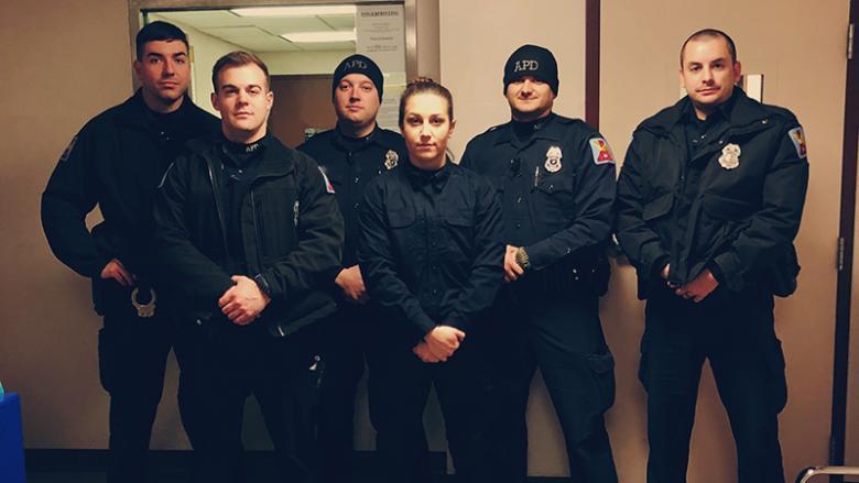 Jordyn Greene with Altoona Police Department Officers