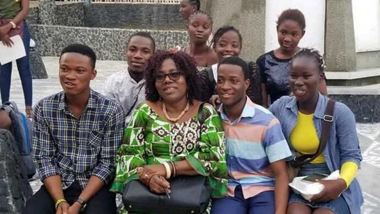 A group of students poses with two of the Mentee-Mentors and Patricia Jabbeh Wesley after the closing program on July 23 in Monrovia, Liberia.