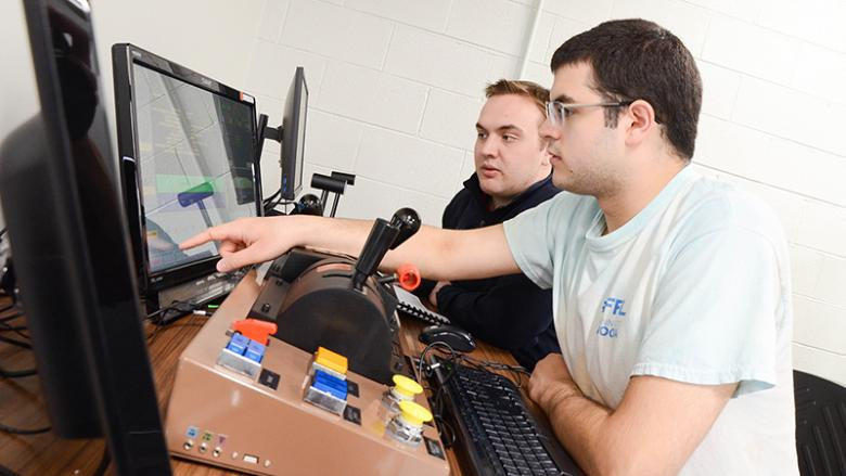 Penn State Altoona students Michael Kozik and John Yohn experiment with the Positive Train Control Prime Simulator from PS Technology.