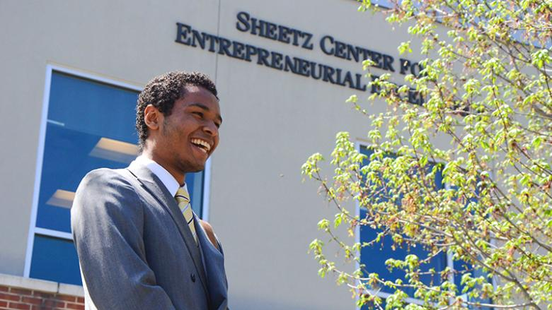Joey Hernandez in front of the Sheetz Center for Entrepreneurial Excellence