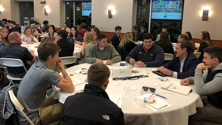 Students interact with local business people at fast track networking event
