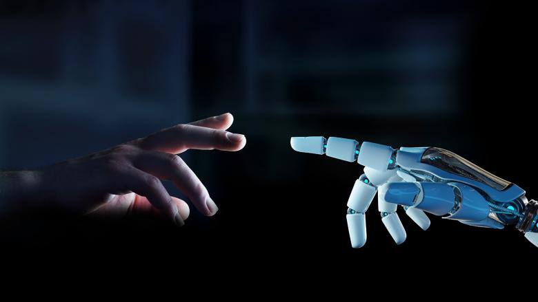 Human hand reaching out to robot hand