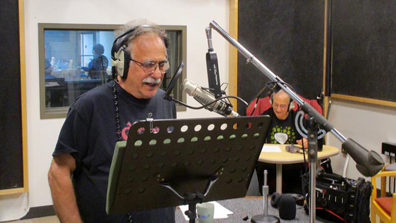 Jerry Zolten records voice overs while Frank Christopher records