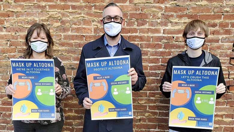 Joey Roesch stands with LaVonne Falbo, Altoona Area Business Community president, and Mayor Matt Pacifico to promote Mask Up Altoona.