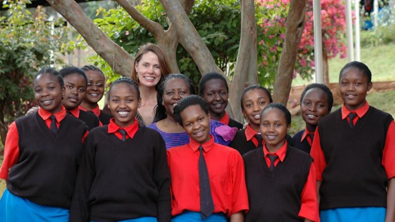 Latsko-Lockhart pictured with the first 10 girls to participate in the Global Give Back Circle.