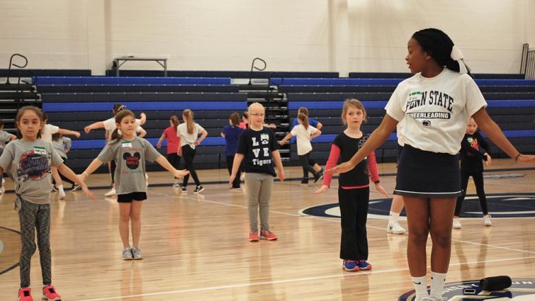 Penn State Altoona cheerleaders run a mini cheer clinic