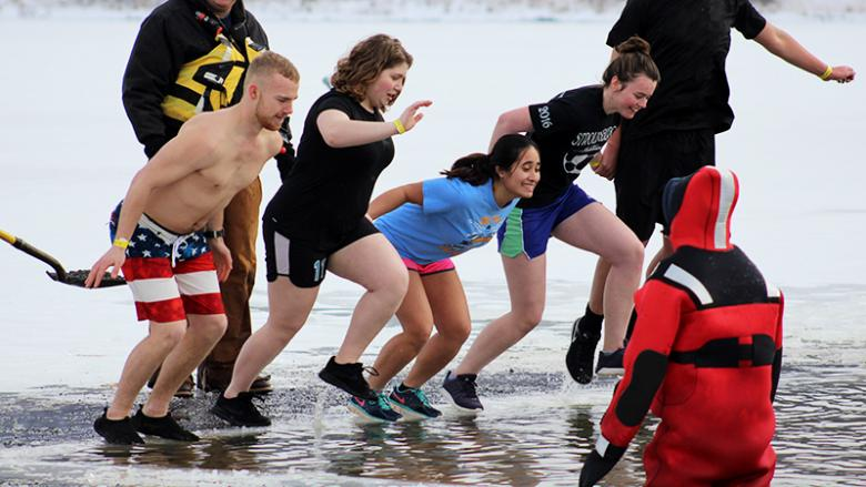 Students jump into icy water to raise funds for the annual Winter Plunge