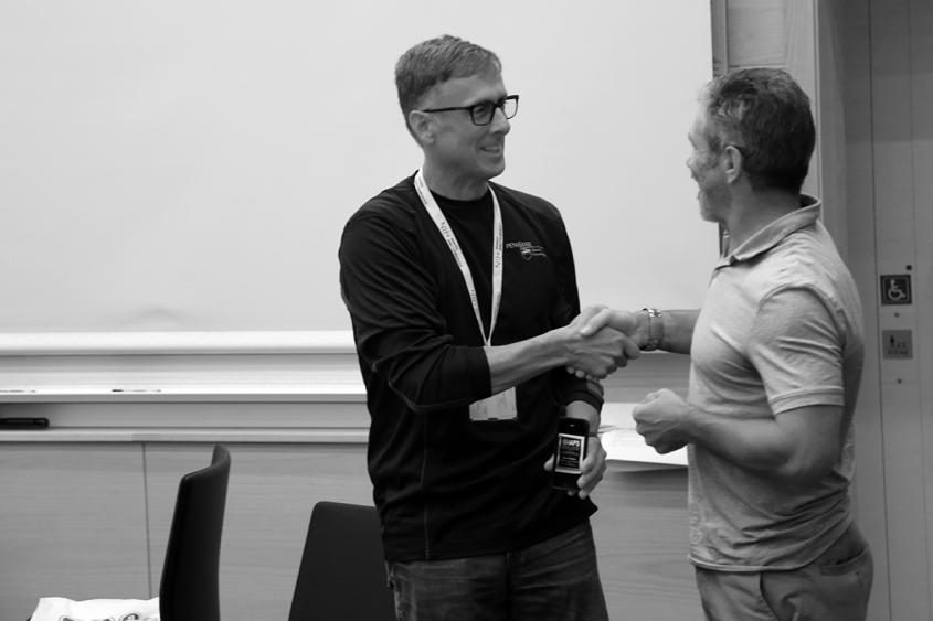 Peter Hopsicker (left) is congratulated by Dr. Alun Hardman, presdient of the IAPS