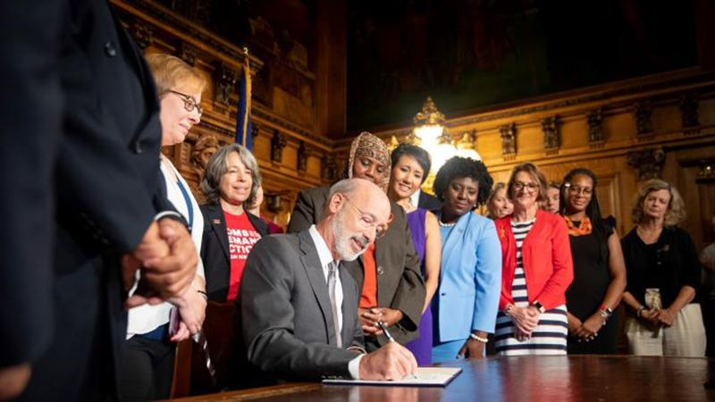 Tom Wolf signs an executive order, making changes to executive branch agencies and programs to better target gun violence in Pennsylvania.